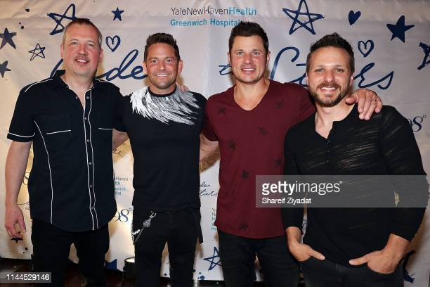Justin Jeffre Jeff Timmons Nick Lachey and Drew Lachey of the group 98 Degrees attend Under The Stars 2019 at Riverside Yacht Club on May 17 2019 in...