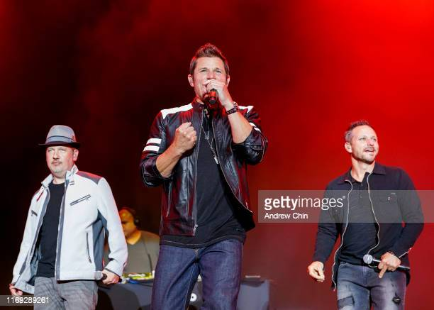 Justin Jeffre Nick Lachey and Drew Lachey of 98 Degrees perform on stage during Summer Night Concerts at PNE Amphitheatre on August 20 2019 in...