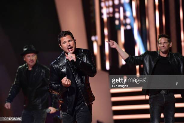 Justin Jeffre Nick Lachey and Jeff Timmons of 98 Degrees perform at the 2018 iHeartRADIO MuchMusic Video Awards at MuchMusic HQ on August 26 2018 in...
