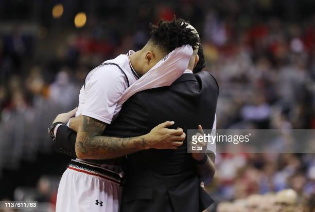 Justin Jenifer and Cane Broome of the Cincinnati Bearcats hug head coach Mick Cronin after being defeated by the Iowa Hawkeyes 7972 in the first...