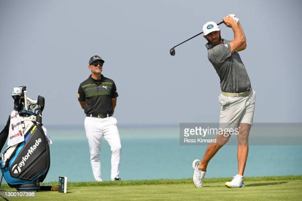 Justin Johnson of the USA watched by his coach Claude Harmon III during the pro-am event prior to the Saudi International powered by SoftBank...