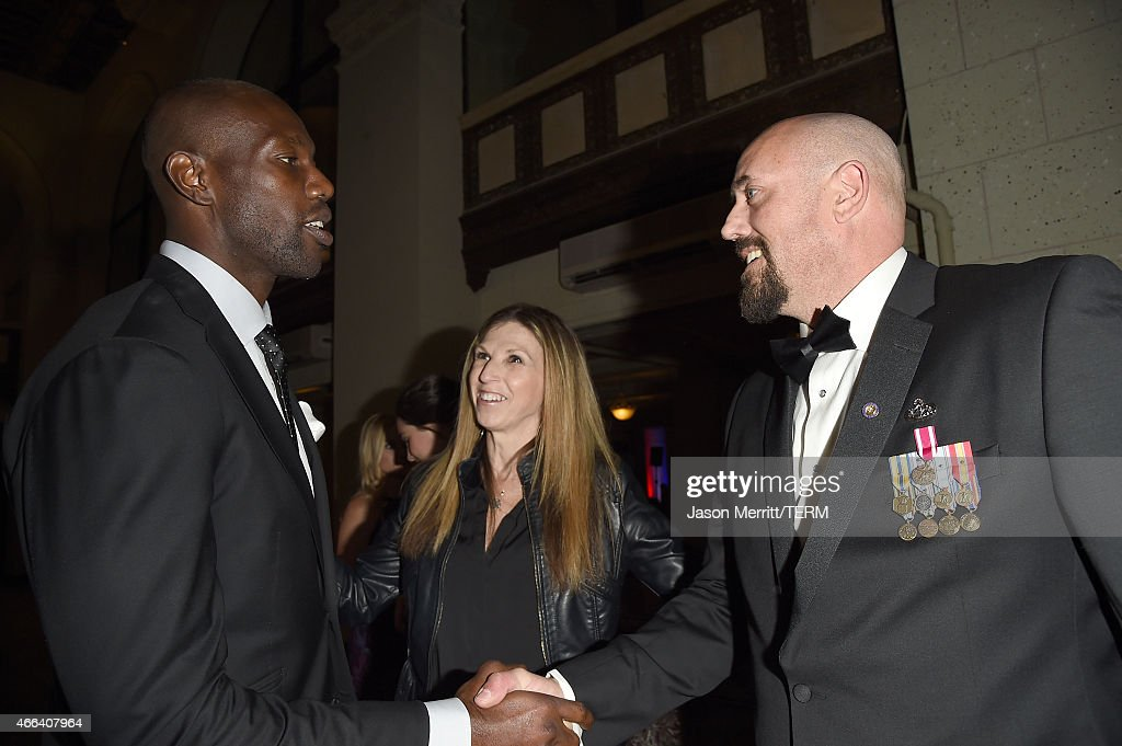 Justin Jordan and Terrell Owens attend the salute to heroes service gala to benefit The National Foundation For Military Family Support at The Majestic Downtown on March 14, 2015 in Los Angeles, California.