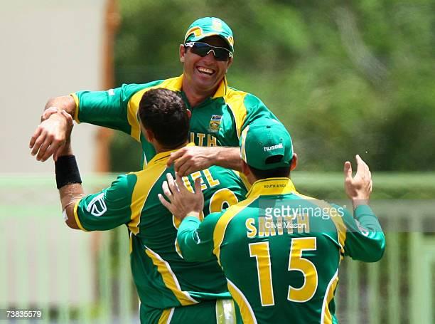 Justin Kemp of South Africa celebrates catching Mushfiqur Rahim of Bangladesh during the ICC Cricket World Cup Super Eights match between Bangladesh...