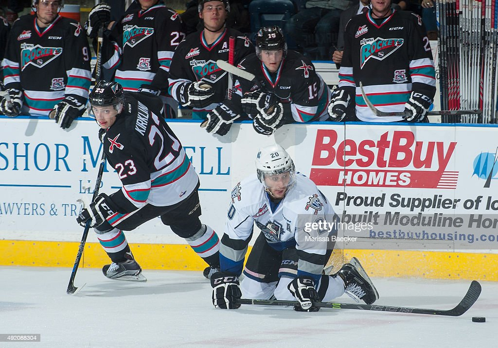 Justin Kirkland #23 of Kelowna Rockets checks Logan Fisher #20 of Victoria Royals to the ice on OCTOBER 9, 2015 at Prospera Place in Kelowna, British Columbia, Canada.