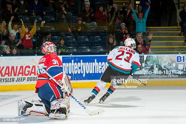 Justin Kirkland of the Kelowna Rockets scores a goal on Eric Williams of the Spokane Chiefs during the third period on March 5, 2014 at Prospera...