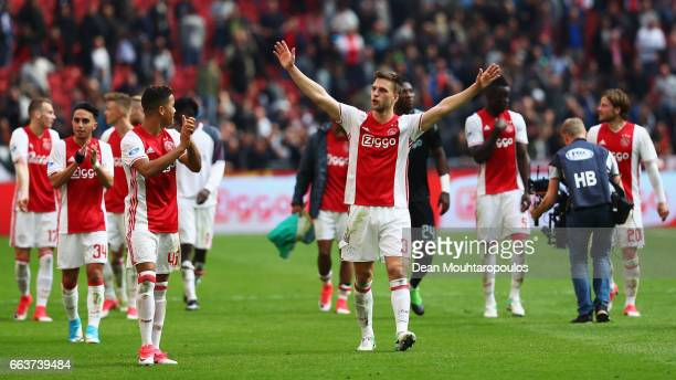 Justin Kluivert and Joel Veltman of Ajax celebrate victory after the Dutch Eredivisie match between Ajax Amsterdam and Feyenoord at Amsterdam ArenA...