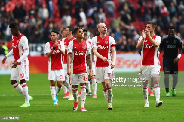Justin Kluivert Davy Klaassen and Joel Veltman of Ajax celebrate victory after the Dutch Eredivisie match between Ajax Amsterdam and Feyenoord at...