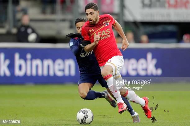 Justin Kluivert of Ajax Alireza Jahanbakhsh of AZ Alkmaar during the Dutch Eredivisie match between AZ Alkmaar v Ajax at the AFAS Stadium on December...