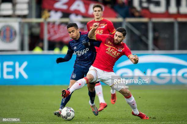 Justin Kluivert of Ajax Alireza Jahanbakhsh of AZ during the Dutch Eredivisie match between AZ Alkmaar and Ajax Amsterdam at AFAS stadium on December...