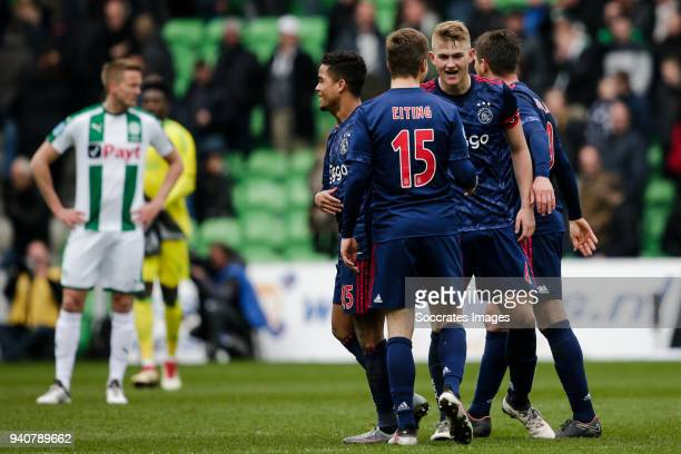Justin Kluivert of Ajax Carel Eiting of Ajax Matthijs de Ligt of Ajax celebrate the victory after the game during the Dutch Eredivisie match between...
