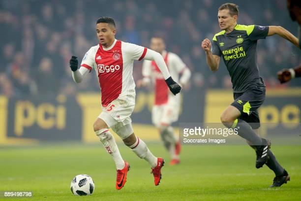Justin Kluivert of Ajax Daniel Schwaab of PSV during the Dutch Eredivisie match between Ajax v PSV at the Johan Cruijff Arena on December 10 2017 in...