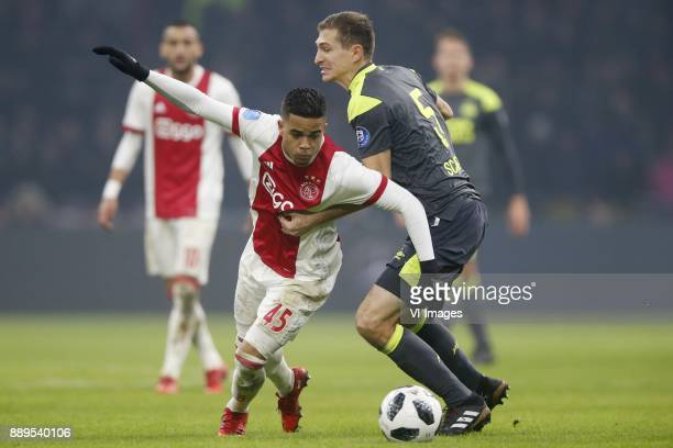 Justin Kluivert of Ajax Daniel Schwaab of PSV during the Dutch Eredivisie match between Ajax Amsterdam and PSV Eindhoven at the Amsterdam Arena on...