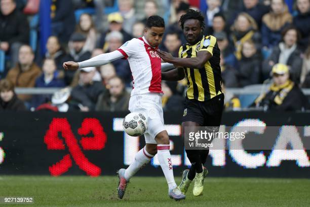 Justin Kluivert of Ajax Fankaty Dabo of Vitesse during the Dutch Eredivisie match between Vitesse Arnhem and Ajax Amsterdam at Gelredome on March 04...