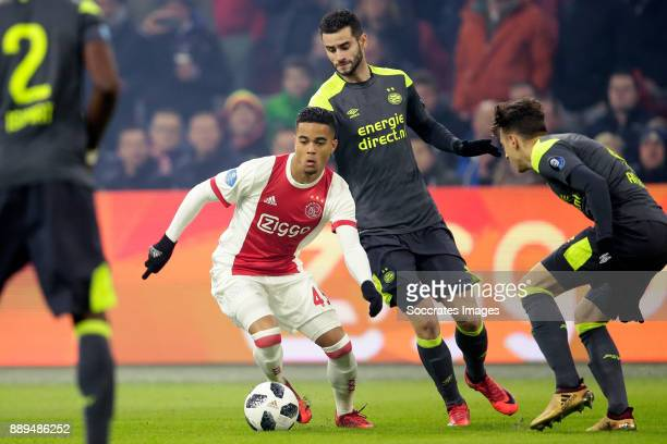 Justin Kluivert of Ajax Gaston Pereiro of PSV during the Dutch Eredivisie match between Ajax v PSV at the Johan Cruijff Arena on December 10 2017 in...