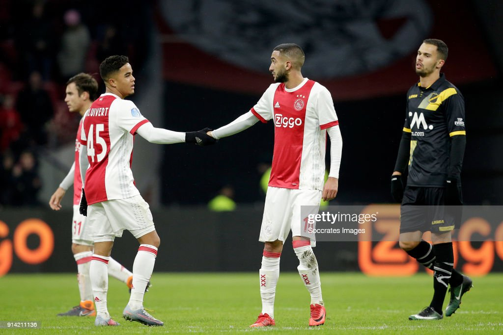 Justin Kluivert of Ajax, Hakim Ziyech of Ajax celebrates the victory during the Dutch Eredivisie match between Ajax v NAC Breda at the Johan Cruijff Arena on February 4, 2018 in Amsterdam Netherlands