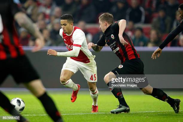 Justin Kluivert of Ajax Jinty Caenepeel of Excelsior during the Dutch Eredivisie match between Ajax v Excelsior at the Johan Cruijff Arena on...