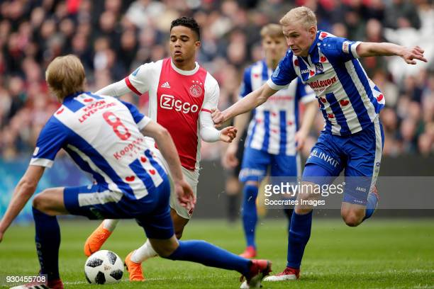 Justin Kluivert of Ajax Lucas Woudenberg of SC Heerenveen during the Dutch Eredivisie match between Ajax v SC Heerenveen at the Johan Cruijff Arena...