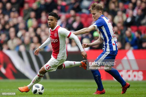 Justin Kluivert of Ajax Martin Odegaard of SC Heerenveen during the Dutch Eredivisie match between Ajax v SC Heerenveen at the Johan Cruijff Arena on...