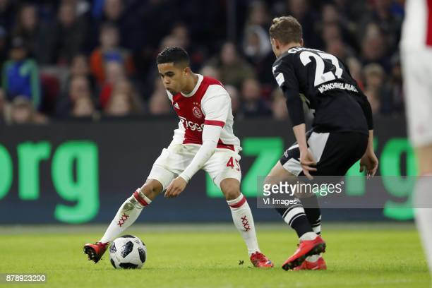 Justin Kluivert of Ajax Mickael Cuisance of Borussia Monchengladbach during the international friendly match between Ajax Amsterdam and Borussia...
