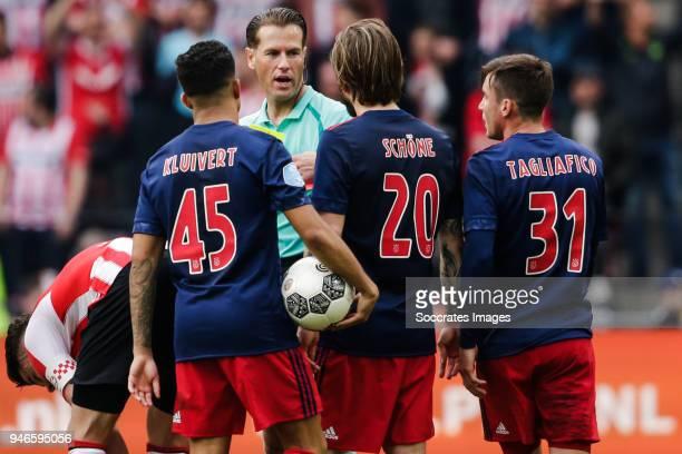 Justin Kluivert of Ajax referee Danny Makkelie Lasse Schone of Ajax Nicolas Tagliafico of Ajax during the Dutch Eredivisie match between PSV v Ajax...