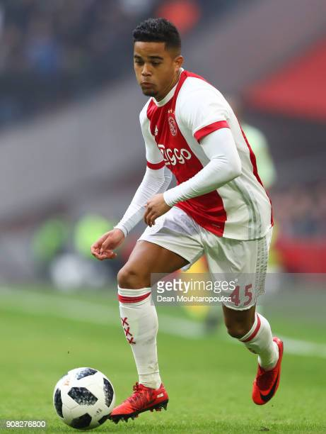 Justin Kluivert of Ajax runs with the ball during the Dutch Eredivisie match between Ajax Amsterdam and Feyenoord at Amsterdam ArenA on January 21...