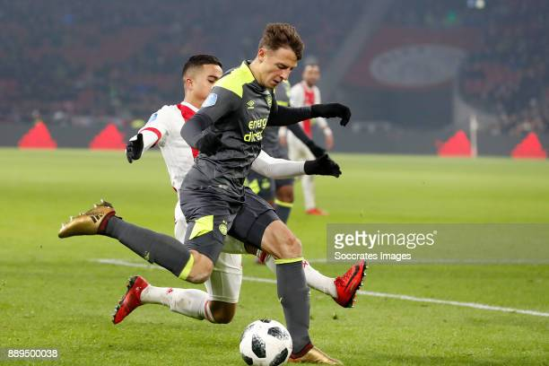 Justin Kluivert of Ajax Santiago Arias of PSV during the Dutch Eredivisie match between Ajax v PSV at the Johan Cruijff Arena on December 10 2017 in...
