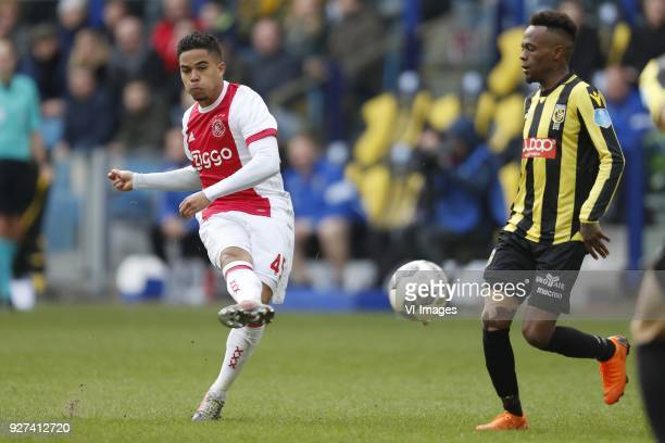 Justin Kluivert of Ajax Thulani Serero of Vitesse during the Dutch Eredivisie match between Vitesse Arnhem and Ajax Amsterdam at Gelredome on March...