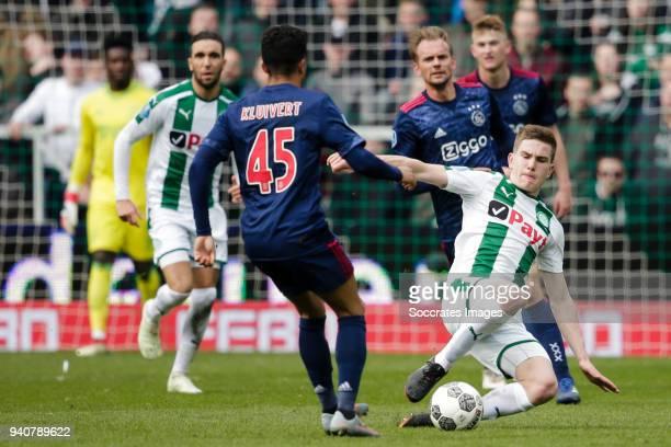 Justin Kluivert of Ajax Tommie van de Looi of FC Groningen during the Dutch Eredivisie match between FC Groningen v Ajax at the NoordLease Stadium on...