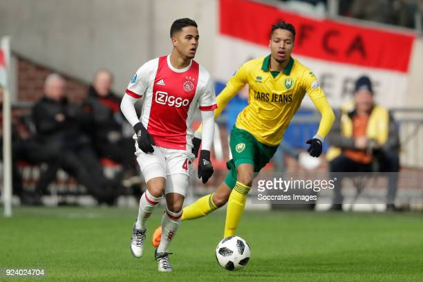 Justin Kluivert of Ajax Tyronne Ebuehi of ADO Den Haag during the Dutch Eredivisie match between Ajax v ADO Den Haag at the Johan Cruijff Arena on...