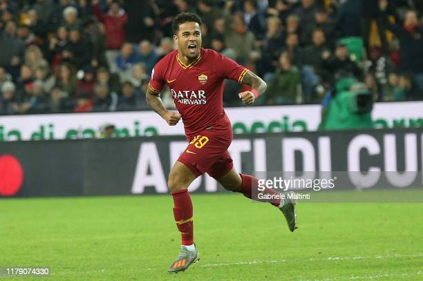 Justin Kluivert of AS Roma celebrates after scoring a goal during the Serie A match between Udinese Calcio and AS Roma at Stadio Friuli on October...