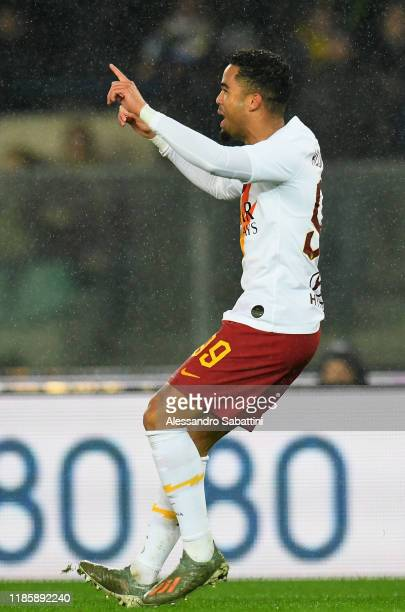 Justin Kluivert of As Roma celebrates after scoring the opening goal during the Serie A match between Hellas Verona and AS Roma at Stadio Marcantonio...