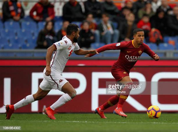 Justin Kluivert of AS Roma competes for the ball with Koffi Dijidji of Torino FC during the Serie A match between AS Roma and Torino FC at Stadio...