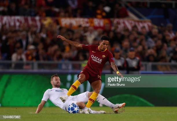 Justin Kluivert of AS Roma competes for the ball with Radim Reznik of Viktoria Plzen during the Group G match of the UEFA Champions League between AS...
