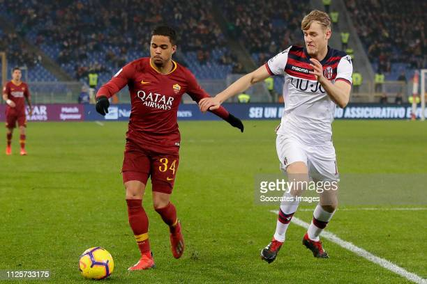 Justin Kluivert of AS Roma Filip Helander of Bologna FC during the Italian Serie A match between AS Roma v Bologna at the Stadio Olimpico Rome on...
