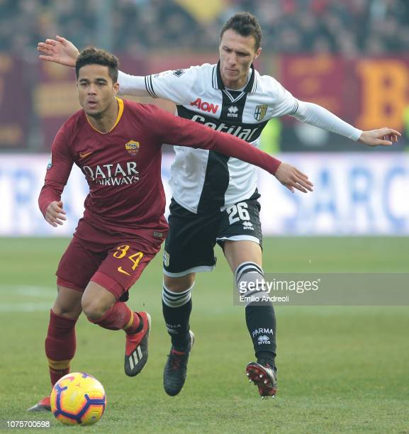 Justin Kluivert of AS Roma is challenged by Luca Siligardi of Parma Calcio during the Serie A match between Parma Calcio and AS Roma at Stadio Ennio...