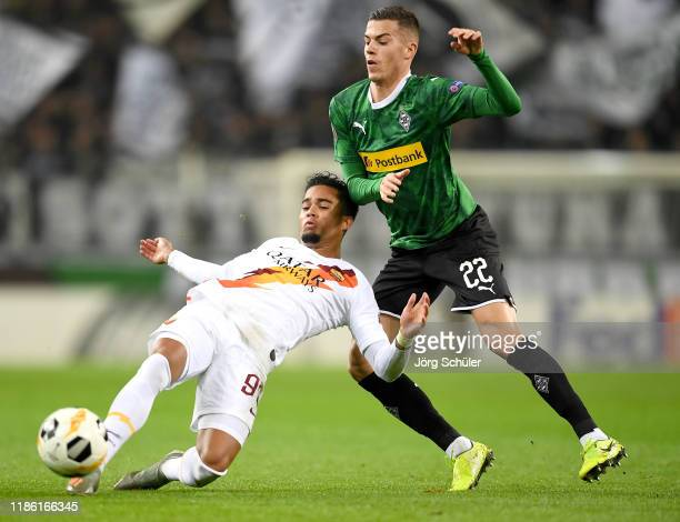 Justin Kluivert of AS Roma is tackled by Laszlo Benes of Borussia Monchengladbach during the UEFA Europa League group J match between Borussia...