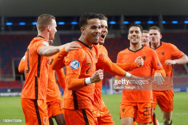 Justin Kluivert of Netherlands celebrates with teammates after scoring their team's first goal during the 2021 UEFA European Under-21 Championship...
