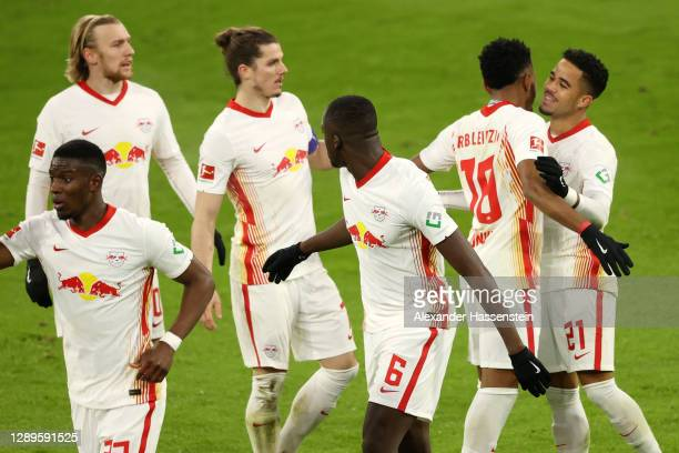 Justin Kluivert of RB Leipzig celebrates with teammate Christopher Nkunku after scoring his team's second goal during the Bundesliga match between FC...