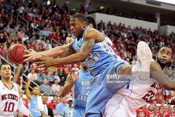 Justin Knox of the North Carolina Tar Heels takes a rebound away from Jordan Vandenberg of the North Carolina State Wolfpack at the RBC Center on...