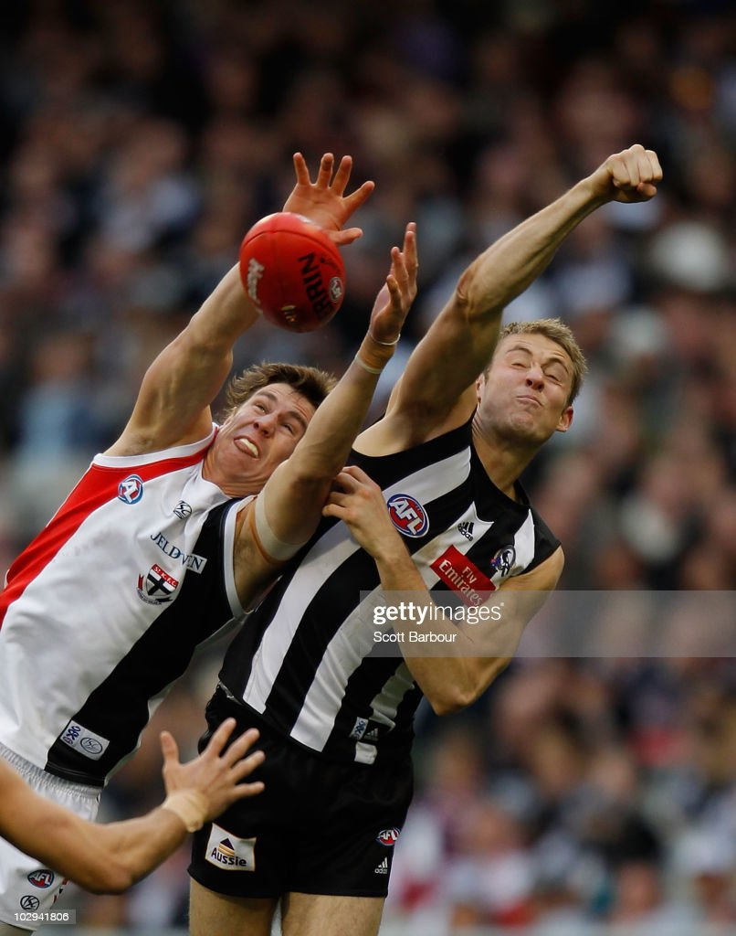 Justin Koschitzke of the Saints and Ben Reid of the Magpies compete for the ball during the round 16 AFL match between the Collingwood Magpies and the St Kilda Saints at Melbourne Cricket Ground on July 17, 2010 in Melbourne, Australia.