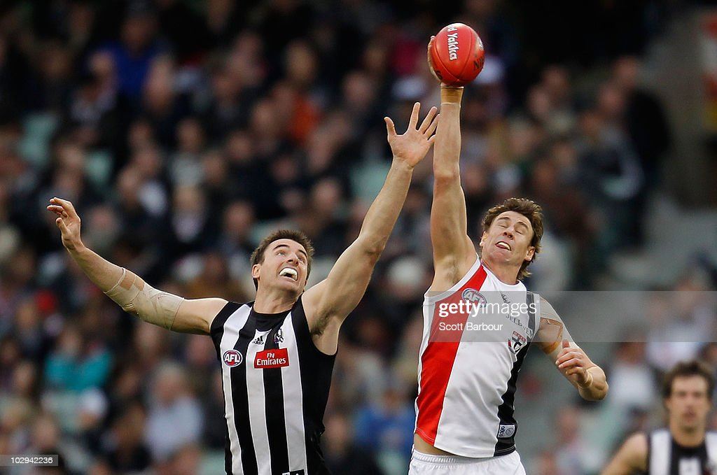 Justin Koschitzke of the Saints and Darren Jolly of the Magpies compete for the ball during the round 16 AFL match between the Collingwood Magpies and the St Kilda Saints at Melbourne Cricket Ground on July 17, 2010 in Melbourne, Australia.