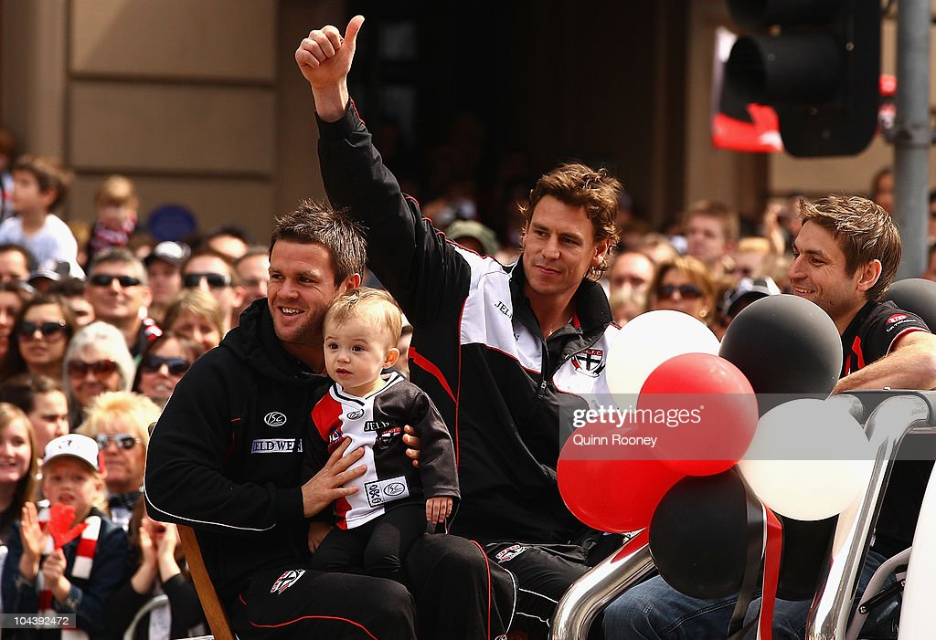 Justin Koschitzke of the Saints waves to the crowd during the AFL Grand Final Parade on September 24, 2010 in Melbourne, Australia.