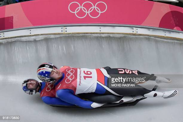 US Justin Krewson and Andrew Sherk compete in the doubles luge run 1 during the Pyeongchang 2018 Winter Olympic Games at the Olympic Sliding Centre...
