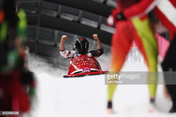 Justin Kripps and Alexander Kopacz of Canada react in the finish area following their final run during the Men's 2Man Bobsleigh on day 10 of the...