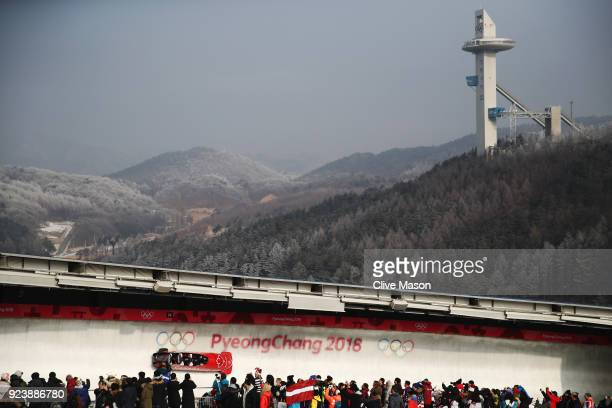 Justin Kripps Jesse Lumsden Alexander Kopacz and Oluseyi Smith of Canada make a run during the 4man Boblseigh Heats on day sixteen of the PyeongChang...