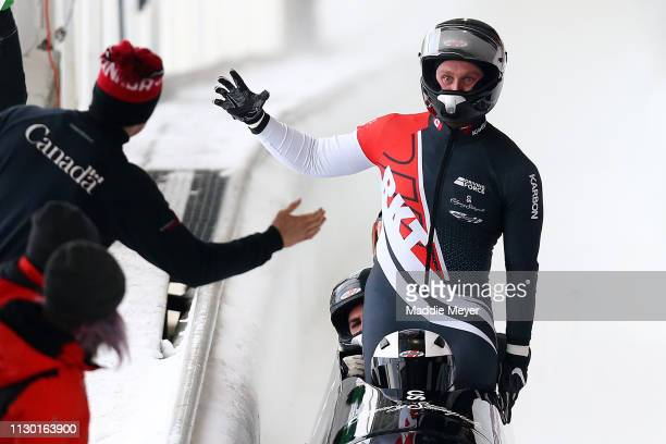 Justin Kripps Ryan Sommer Cameron Stones and Benjamin Coakwell of Canada celebrate after the second run of the 4man bobsleigh competition on day 2 of...