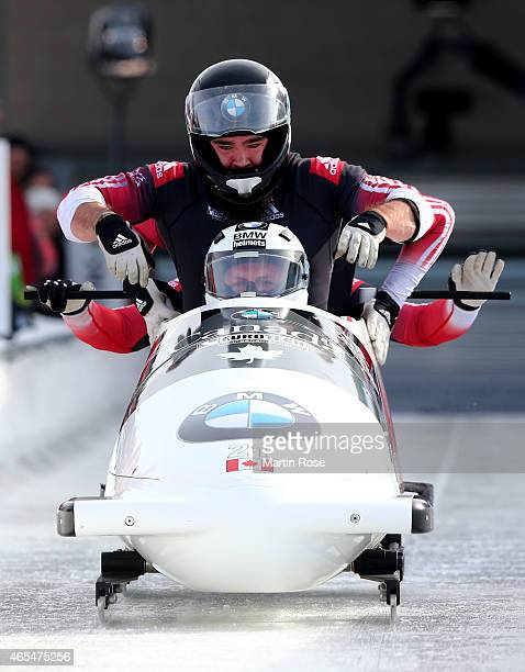 Justin Kripps Timothy Randall Bryan Barnett and Ben Coakwell of Canada compete in their first run of the four man bob competition during the FIBT Bob...