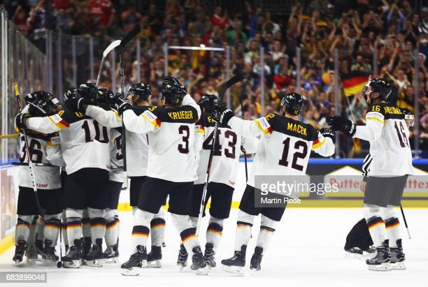 Justin Krueger of Germany celebrates with team mates after victory in the Germany v Latvia match of the 2017 IIHF Ice Hockey World Championships at...