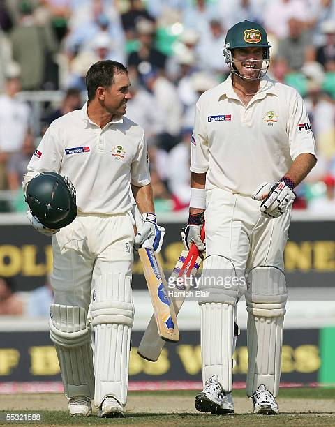 Justin Langer and Matthew Hayden of Australia leave the field together at lunch during day two of the Fifth npower Ashes Test between England and...
