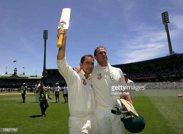 Justin Langer and Matthew Hayden of Australia salute the crowd at the end of day four of the fifth Ashes Test Match between Australia and England at...